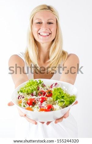 Portrait of happy young woman holding healthy food. - stock photo