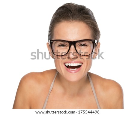 Portrait of happy young woman in eyeglasses looking in camera