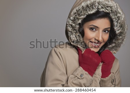 Portrait of happy young woman in winter clothes - stock photo