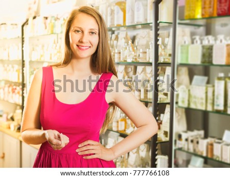 portrait of happy young woman  looking excited and shopping at the natural cosmetics shop