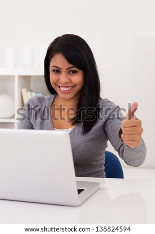 Portrait Of Happy Young Woman Using Laptop - stock photo