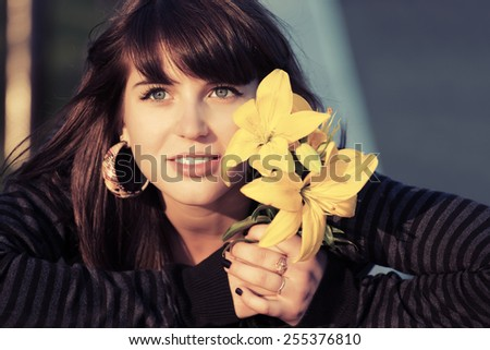 Portrait of happy young woman with a flowers  - stock photo