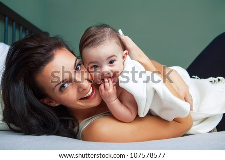 Portrait of happy young woman with her baby