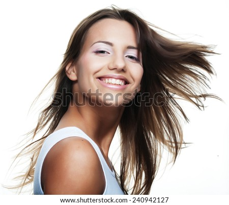 Portrait of happy young woman with wind in hair