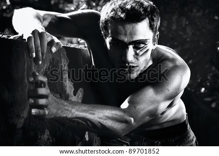 portrait of hard military handsome male model - black and white version - stock photo