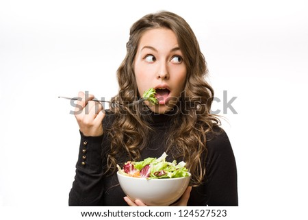 Portrait of healthy eating beautiful young brunette woman.
