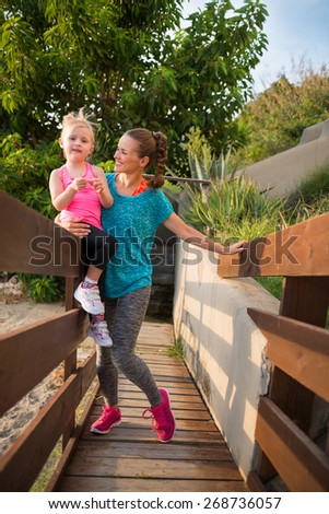 Portrait of healthy mother and baby girl outdoors