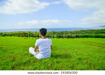 portrait of healthy young man doing yoga - stock photo