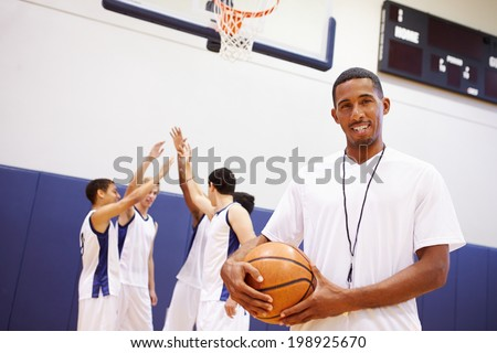 Portrait Of High School Basketball Coach - stock photo