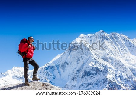 portrait of hiker looking at the horizon in the mountains