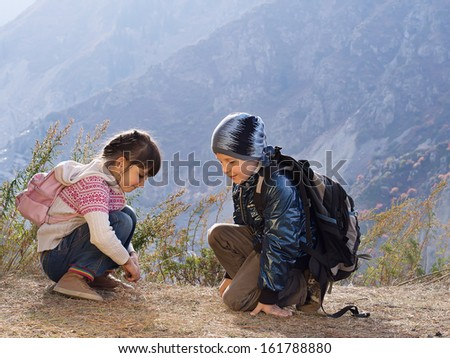 Portrait of hiking caucasian boy and girl
