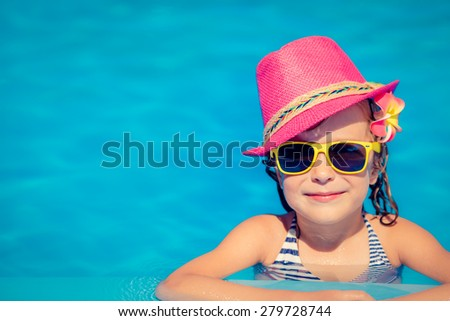 Portrait of hipster child in swimming pool. Summer vacation concept - stock photo
