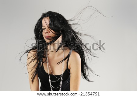 Portrait of hispanic Brunette beauty with long hair flowing