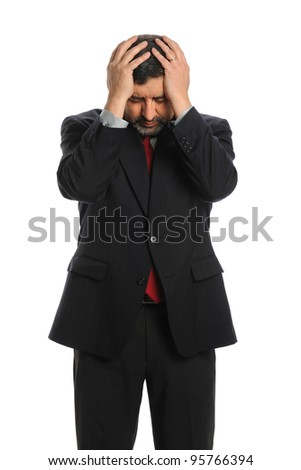 Portrait of Hispanic businessman stressed with hands on head isolated over white background