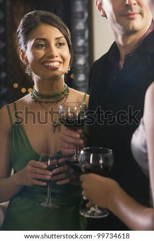 Portrait of Hispanic woman at party - stock photo