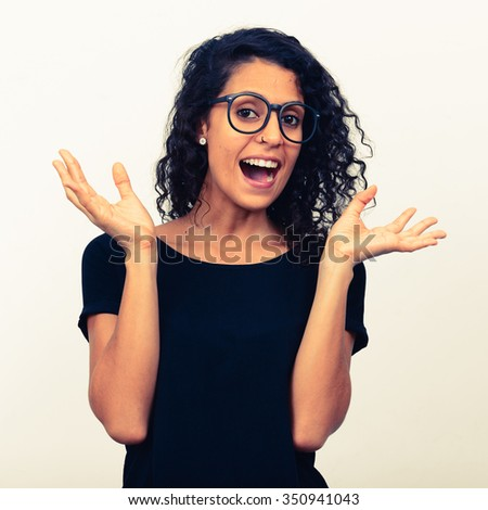 Portrait of Hispanic woman wearing eyeglasses and looking happy