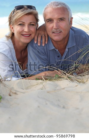 Portrait of holidaymakers at the beach - stock photo