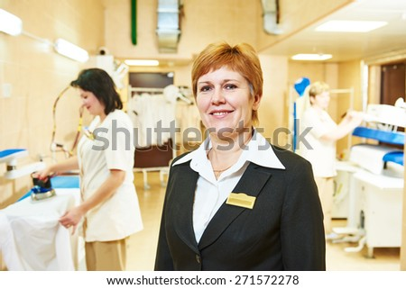 Portrait of hotel linen cleaning service manager - stock photo