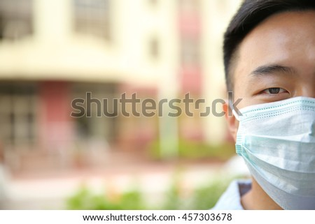 Portrait of ill man in mask on the street - stock photo