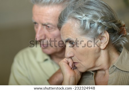 Portrait of ill senior couple close up - stock photo