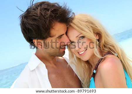 Portrait of in loved couple on beach holidays - stock photo