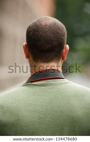 Portrait of incognito man, back view. - stock photo