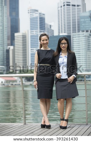 Portrait of Indian business man and woman in a modern urban setting. - stock photo
