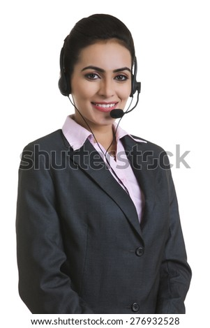 Portrait of Indian businesswoman wearing headset isolated over white background