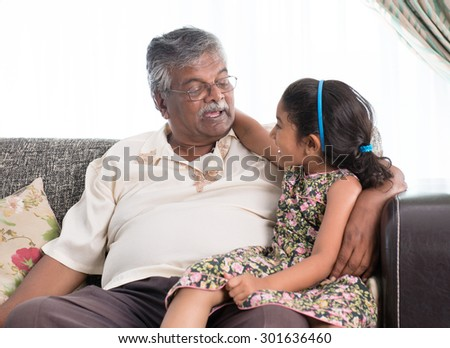 Portrait of Indian family at home. Grandparent and grandchild chatting. Asian people living lifestyle. Grandfather and granddaughter.