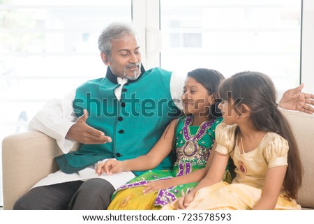 Portrait of Indian family bonding at home. Happy Asian father and children indoors lifestyle.