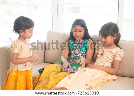 Portrait of Indian family having fun at home. Happy Asian children indoors lifestyle.