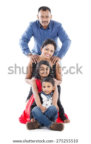 Portrait of indian family isolated on white background - stock photo