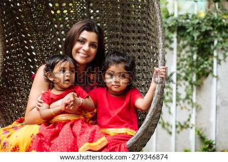 Portrait of Indian family of mother and two daughters - stock photo