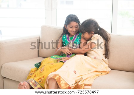 Portrait of Indian family playing at home. Happy Asian children indoors lifestyle.