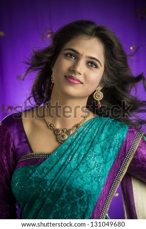Portrait of Indian girl in traditional Indian sari. - stock photo