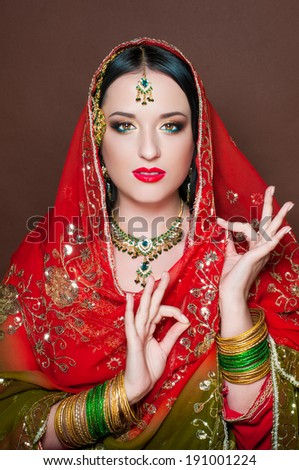 Portrait of Indian girl in traditional Indian sari and indian makeup - stock photo