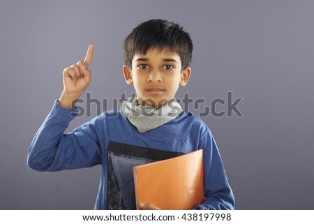 Portrait of Indian School Boy with Textbook - stock photo