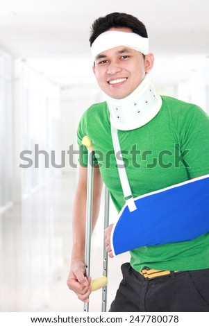 portrait of injured young man keep smile - stock photo