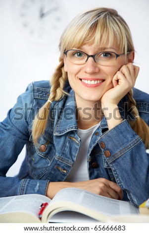 portrait of Intelligence girl student reading  book in classroom - stock photo