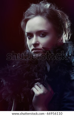 Portrait of irresistible woman in low key, mixed light, low shutter speed. - stock photo