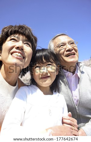 Portrait of Japanese grandparents and granddaughter