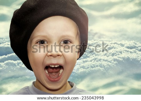 Portrait of joyful baby beret winter background. - stock photo