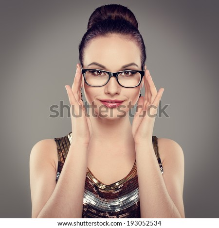 Portrait of joyful brunette girl touching her stylish spectacles. Young attractive woman model wearing eyeglasses looking at camera.     - stock photo