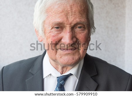Portrait of joyful elderly man of eighty years.Portrait of business man looking at camera.