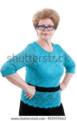 Portrait of joyful European senior woman holding arms akimbo, isolated on white background