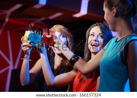 Portrait of joyful friends toasting at party  - stock photo