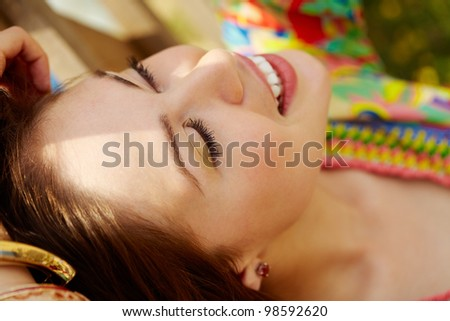 Portrait of joyful girl relaxing outdoors - stock photo
