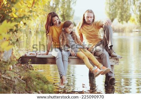Portrait of joyful happy family together at outdoor park. Photo toned style Instagram filters. - stock photo
