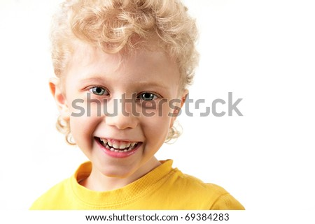 Portrait of joyful lad laughing in yellow t-shirt - stock photo