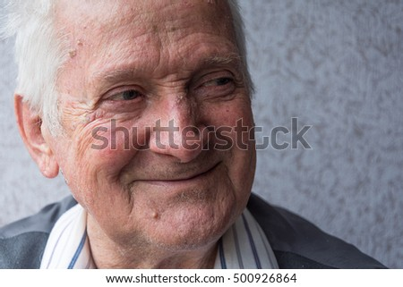 Portrait of joyful man of eighty years.